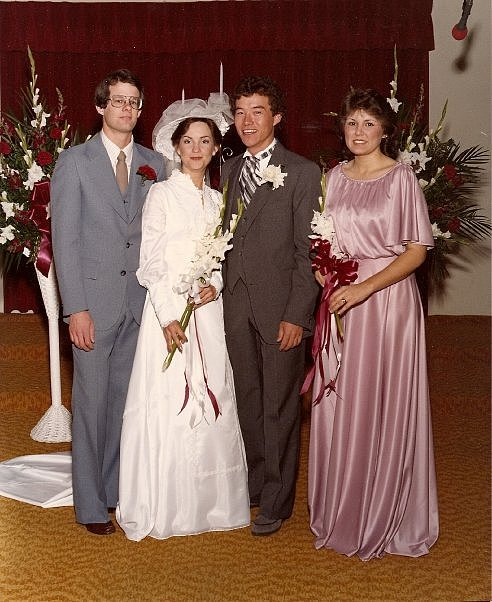 The shoulders are relatively understated for this pink bridesmaid dress in 1982.