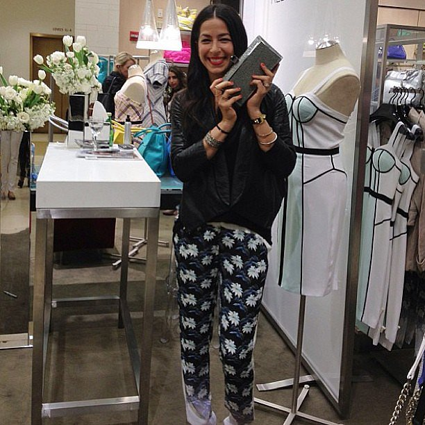 Rebecca Minkoff posed with one of her cool clutches during a Nordstrom in-store appearance. Source: Instagram user rebeccaminkoff