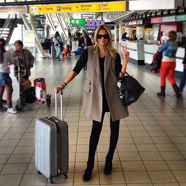 Natasha Poly snapped a photo of her pitch-perfect airport style while traveling to Moscow. Source: Instagram user natashapoly
