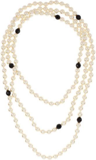 Getting the Great Gatsby look is as easy as styling a pearl necklace, like this Kenneth Jay Lane Multi-Strand Faux Pearl Necklace ($170) with your day and night-out looks.