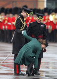 Prince William was quite the gentleman helping Kate Middleton with her shoe in March 2013 in England.