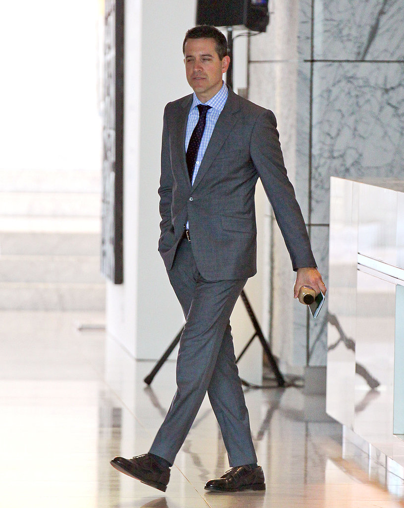 Jim Toth wore a gray suit to work.