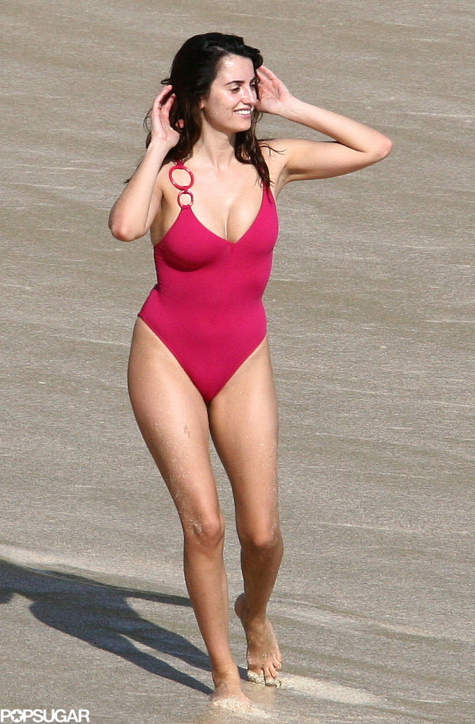 Penélope Cruz channeled a Baywatch beauty in a red one-piece suit while hitting the beaches of St. Barts in December 2006.