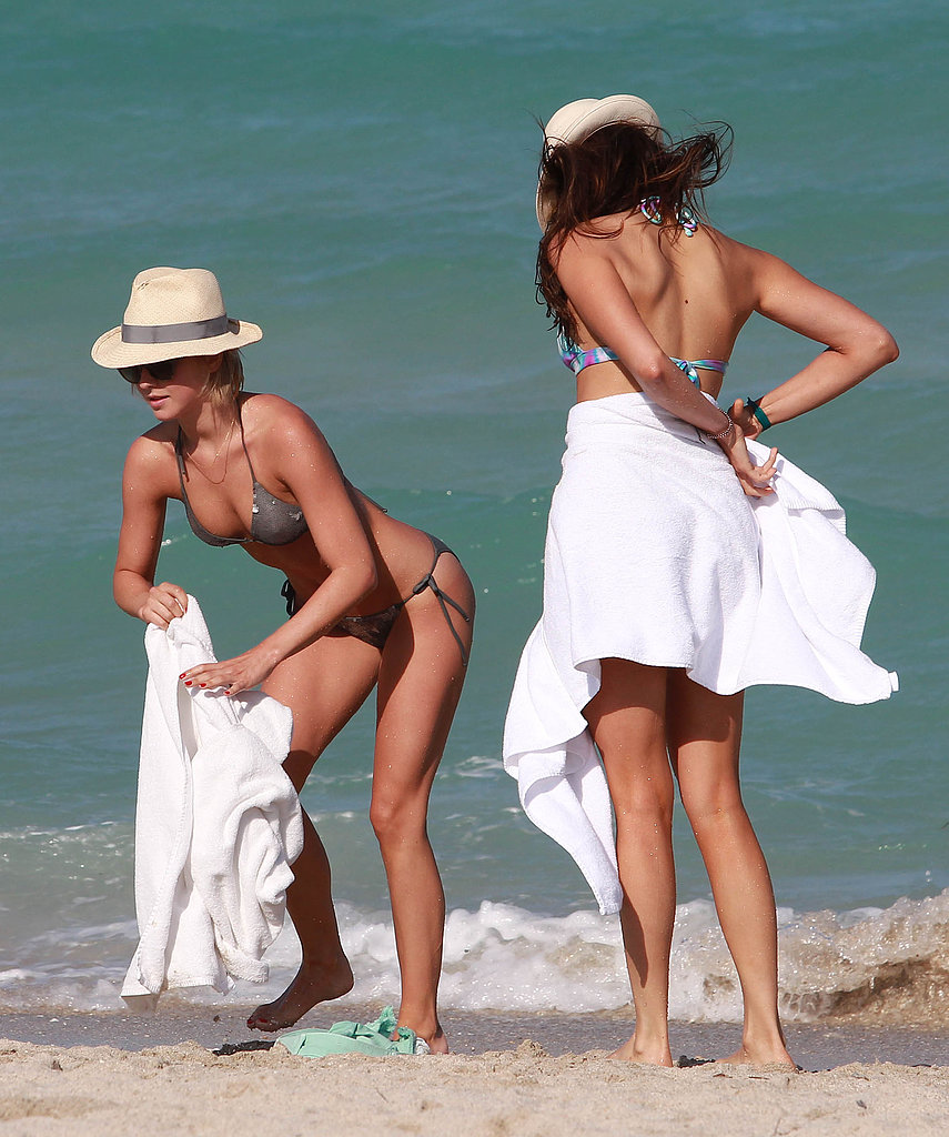 Julianne Hough and Nina Dobrev covered up on the beach in Miami.