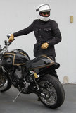 Orlando Bloom wore a helmet and gloves to ride his bike.
