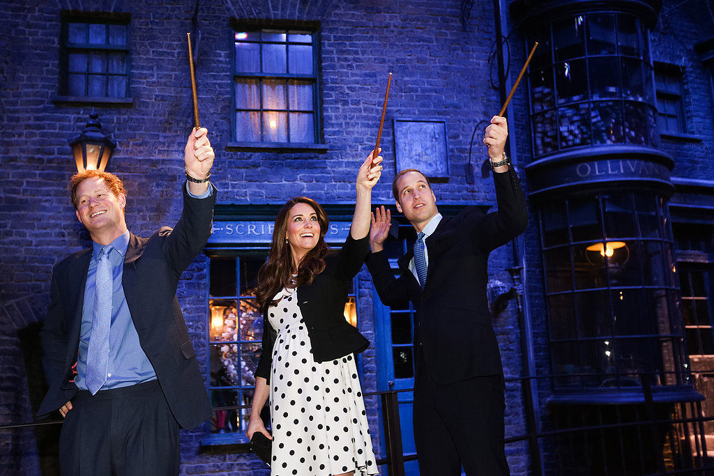 Kate Middleton, Prince Harry, and Prince William played with wands.