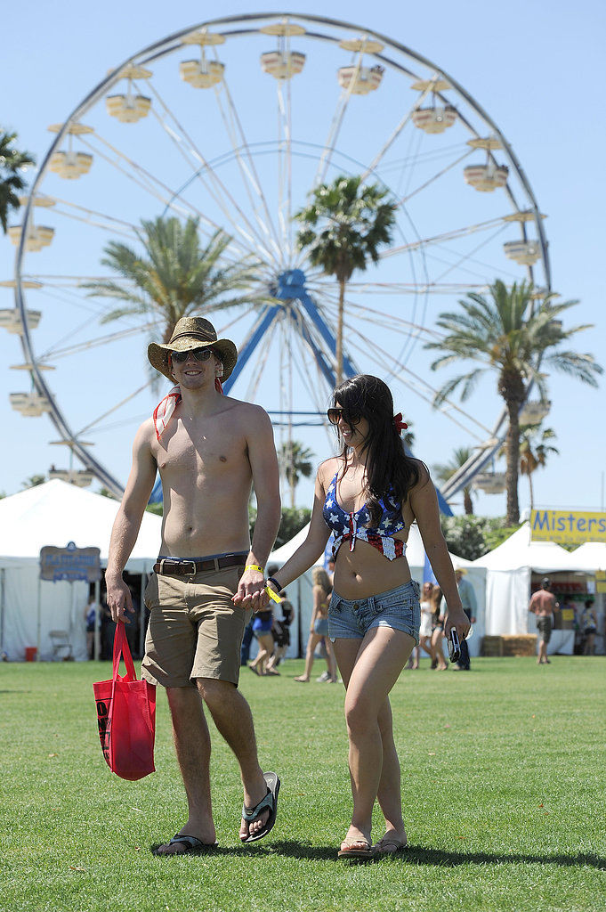 A couple walked hand in hand at Stagecoach.