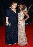 Rebel Wilson and Gabby Douglas stopped for a photo on the red carpet.