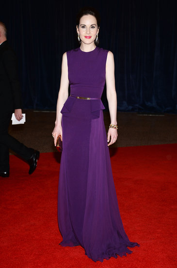 Michelle Dockery lit up the carpet in a violet, peplum-trimmed Elie Saab gown and a Monica Rich Kosann clutch.