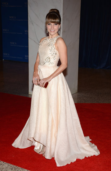 Sophia Bush chose a sweet, cream-colored, and embroidered full-skirted Lela Rose gown with a hemline that revealed just a peek of her Rene Caovilla heels.