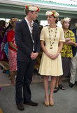 The couple posed — both with floral wreaths on their heads — on day eight of their Diamond Jubilee tour. For a visit to Nauti Primary School in Tuvalu, Kate wore a daisy-eyelet yellow dress with tan sandals.