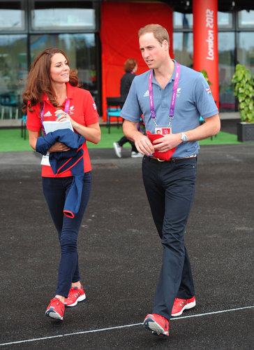 Looking totally decked out in sports gear, Prince William and Kate Middleton took in day one of the London Paralympic Games in coordinated reds and blues.