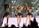 Beyoncé and her dancers busted a move in matching black and gold getups.