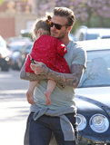 David Beckham carried a sleepy Harper Beckham through London.