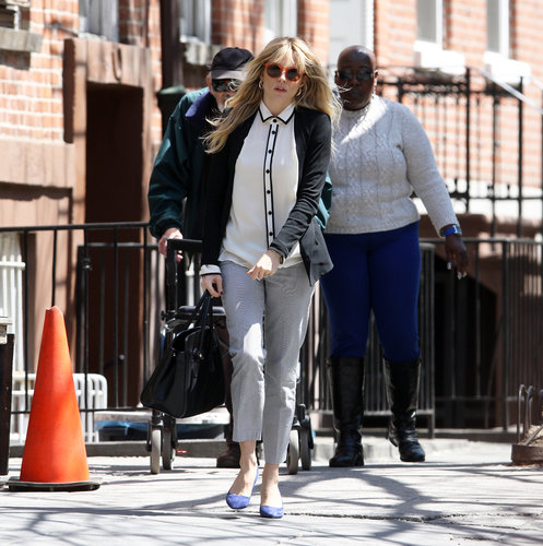 Sienna Miller took a stylish stroll in NYC wearing striped pants with a two-tone blouse and blue flats.