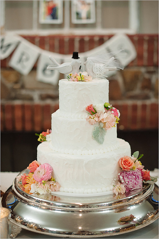 From the doves to the florals to the white beads, everything about this cake says timeless.  Photo by Brett Heidebrecht via Wedding Chicks