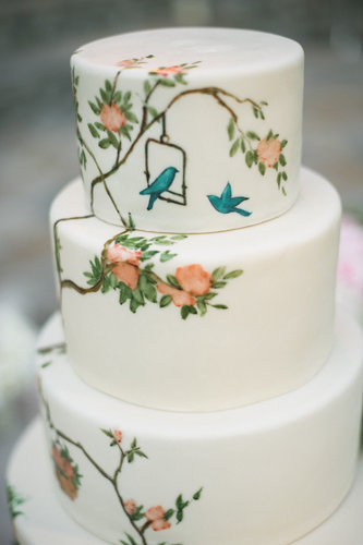 Painted wedding cakes are inherently special, and we think this particular one with its bird and floral design is just fabulous.  Photo by  Amy and Stuart Photography via Style Me Pretty