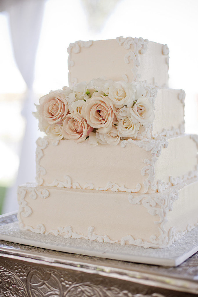 Tradition meets style when it comes to this pretty, off-white, square cake.   Photo by Elyse Hall Photography via Style Me Pretty