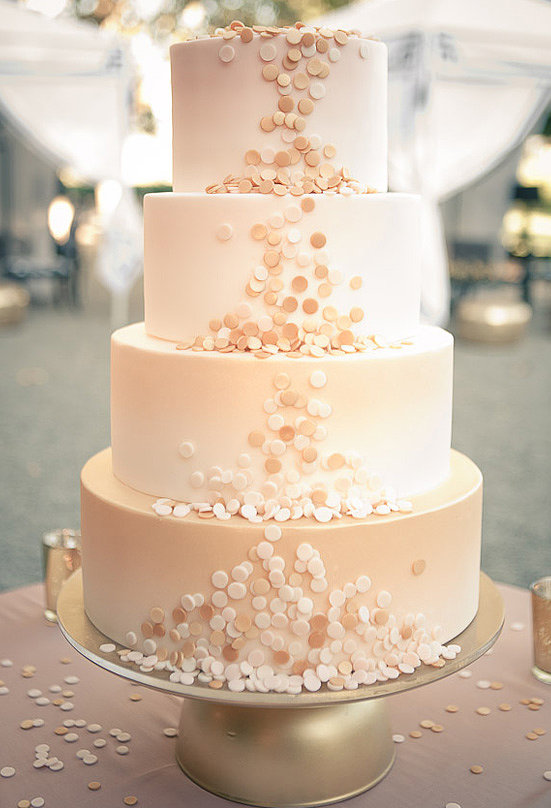 Count this as the most elegant confetti we've ever seen. The fun details on this four-layered, blush-colored wedding cake are pretty exceptional.  Photo by Gary Ashley, Wedding Artists Collective via 100 Layer Cake