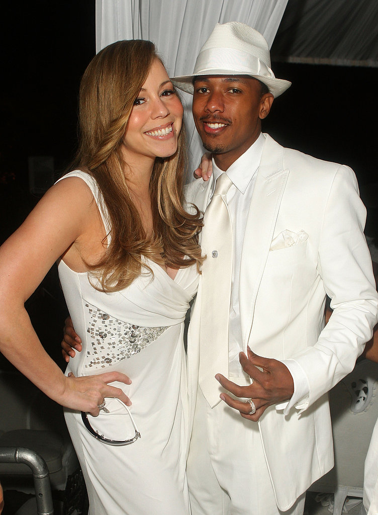 Mariah Carey and Nick Cannon were decked out in matching all-white outfits for P. Diddy and Ashton Kutcher's Malaria charity event in LA in July 2009.