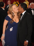 Nick Cannon showed Mariah Carey red carpet love in LA during the March 2010 Academy Awards.