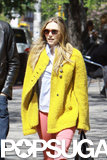 Elizabeth Olsen wore a bright yellow coat in NYC.