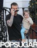 David Beckham held Harper during a morning stroll.