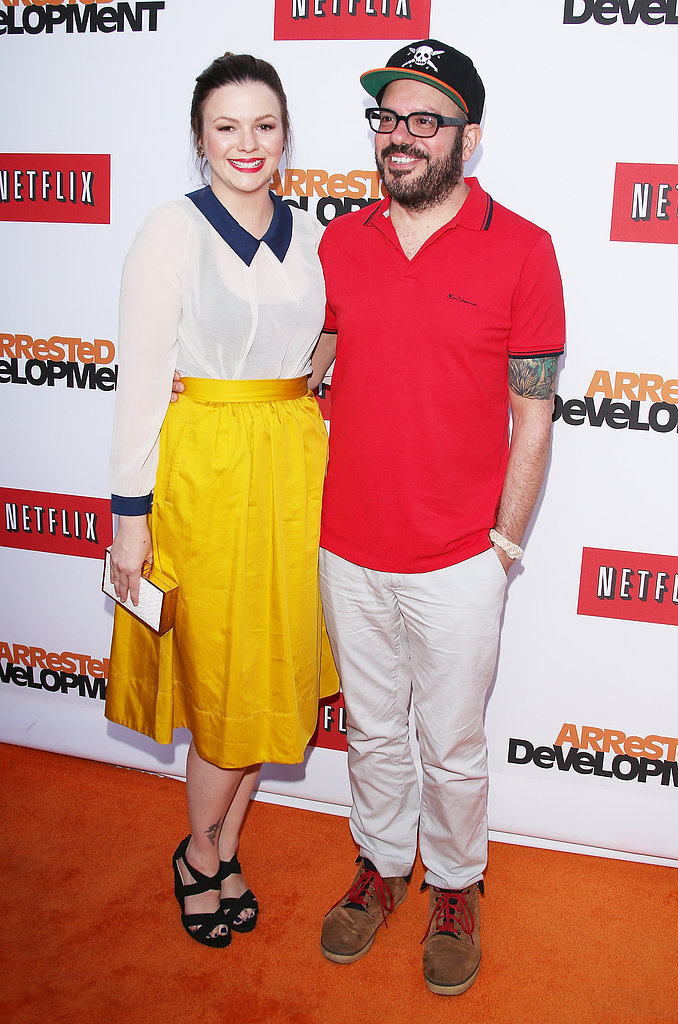 David Cross cuddled with a Costa Blanca-wearing Amber Tamblyn, who clutched onto an Inge Christopher bag and wore ShoeMint shoes.