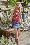 Tansy was the epitome of country chic in a floral tank, denim skirt, and cowboy boots while taking her precious pooch for a stroll. Step into Summer with this blossoming French Connection tank ($20, originally $78) and an on-trend denim mini.