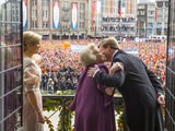 Princess Beatrix of the Netherlands kissed her son King Willem-Alexander of the Netherlands as Queen Maxima of the Netherlands watched during a short address on the balcony of the Royal Palace in Amsterdam, Netherlands.