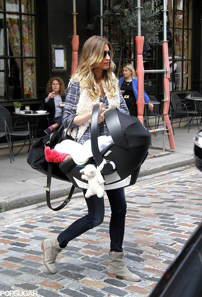 Gisele Bündchen toted her little daughter to the car on Tuesday.