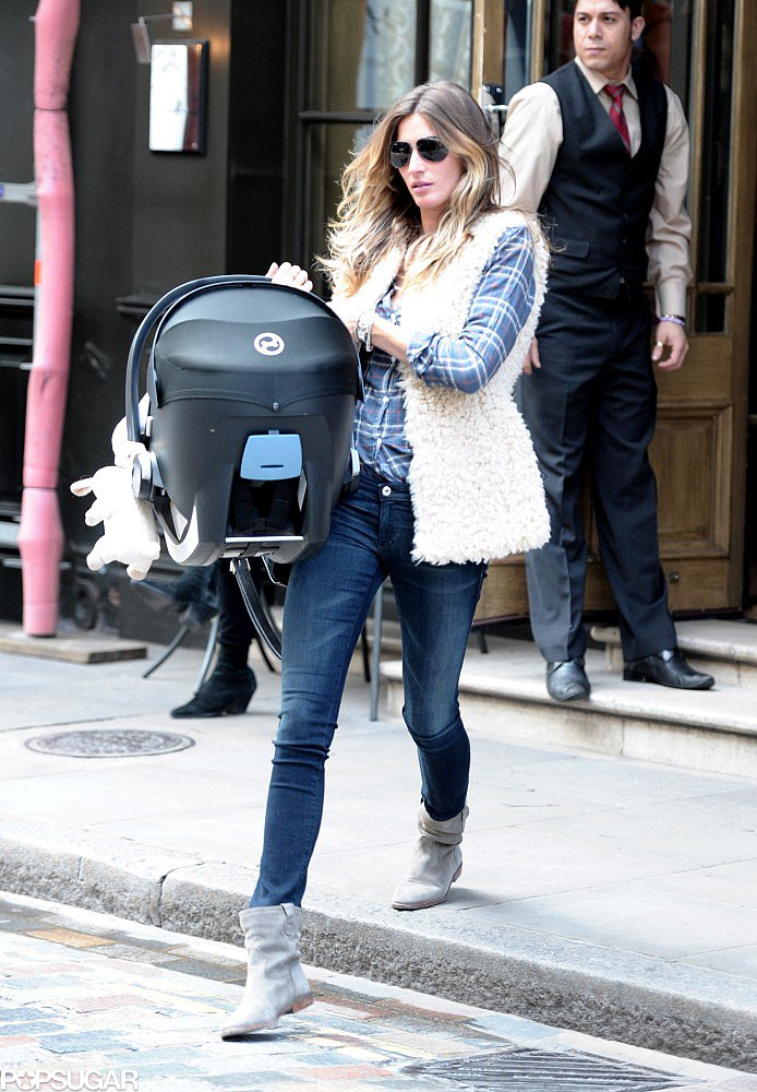 Gisele Bündchen carried her daughter Vivian Brady through London.