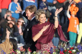 King Willem-Alexander and Queen Maxima waved aboard the king's boat for the water pageant to celebrate the inauguration.
