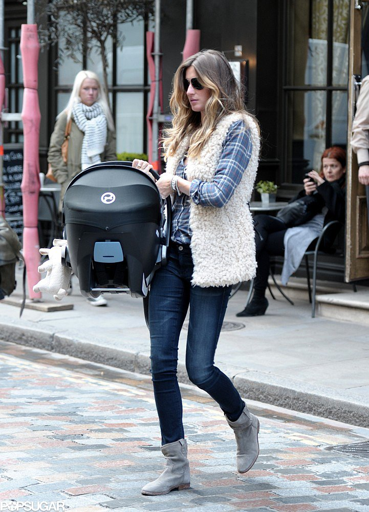 Gisele Bündchen showed up in London wearing a plaid button-down, which she gave a cozy twist via a shearling scarf. She then added skinny denim, a pair of gray boots, and aviator sunglasses.