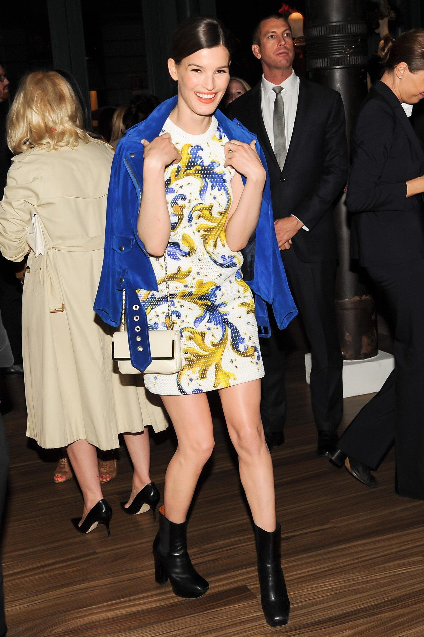 Hanneli Mustaparta showed off her styling skills on a printed minidress, cobalt suede moto jacket, ankle boots, and mini chain bag at the Prada and The Great Gatsby soiree.