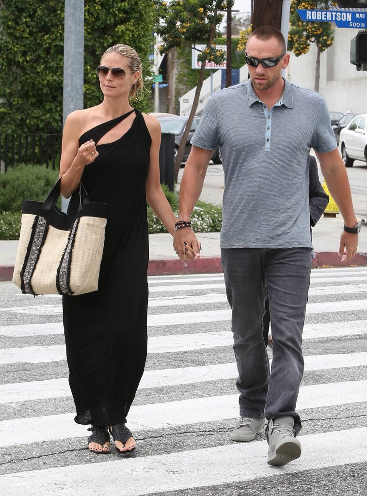 While taking a romantic daytime stroll in NYC, Heidi Klum donned this Max Studio black asymmetrical maxi dress ($98, originally $198), which we think would look just as good at a nighttime affair with heels and shiny jewels.