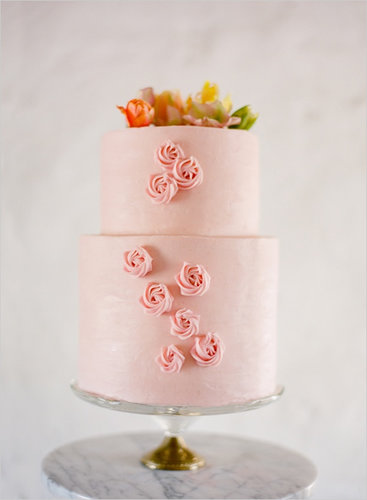 "Never before have the words ""pink"" and ""pretty"" rung so true. It's as if someone came in and — like a piece of, err, cake — easily added the perfectly piped roses.  Photo by Jose Villa via Wedding Chicks"