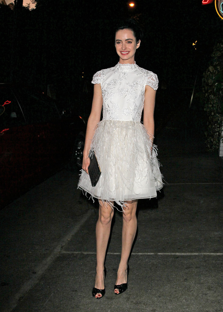 Krysten Ritter's white Alice + Olivia dress offered no shortage of fancy details during an evening out in LA. The feather skirt was particularly sassy.