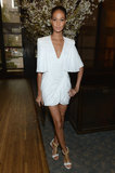 Joan Smalls gave a nod to a Grecian style in her little white plunging dress and chain-detailed white sandals at an event in NYC.