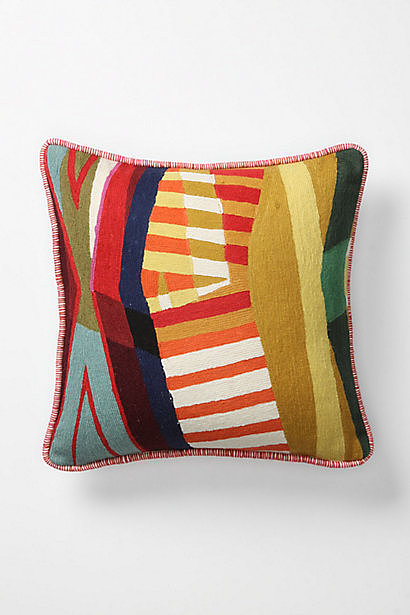This colorful collage pillow ($88) is great way to mix and match neutral shades with bright colors.