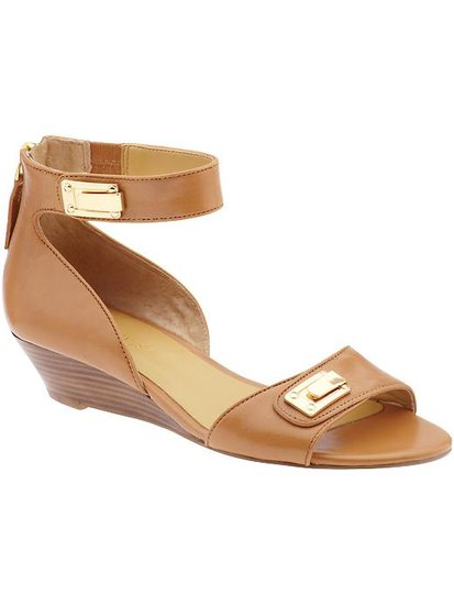 Nine West's Violin Sandals ($89) are sleek and Summer-ready and have a sturdy wooden wedge for wearing with cropped pants and dresses alike.