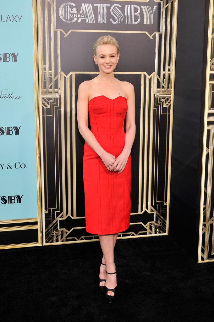 The Great Gatsby star Carey Mulligan showed off her minimalist style in a gorgeous strapless red Lanvin dress paired with black Brian Atwood platform sandals and Tiffany jewelry.