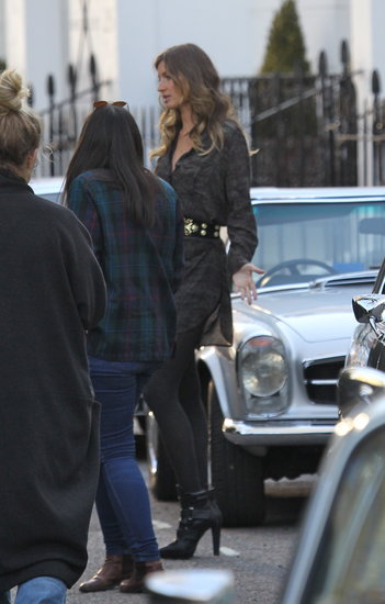 Gisele was spotted shooting the H&M Fall '13 campaign, wearing a printed shirtdress and bold studded belt.