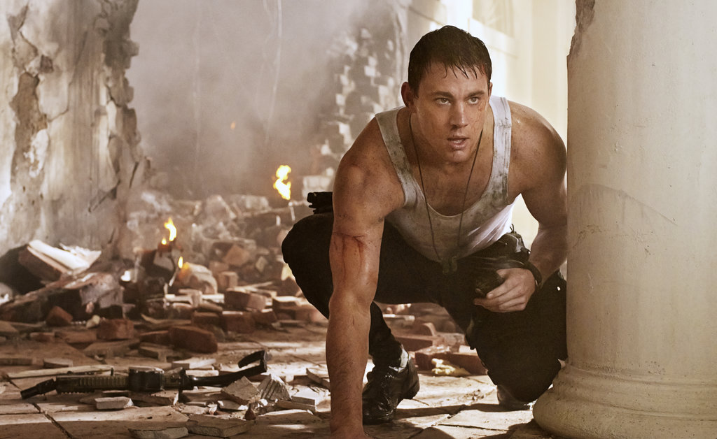 Channing Tatum as John Cale Sporting handsome suits and tight tank tops as a DC policeman in White House Down, Channing Tatum has us swooning all over again with his latest role. We can't decide which look we love more: the sweaty, on-duty version or the dapper, dressed-up style. We'll take both.