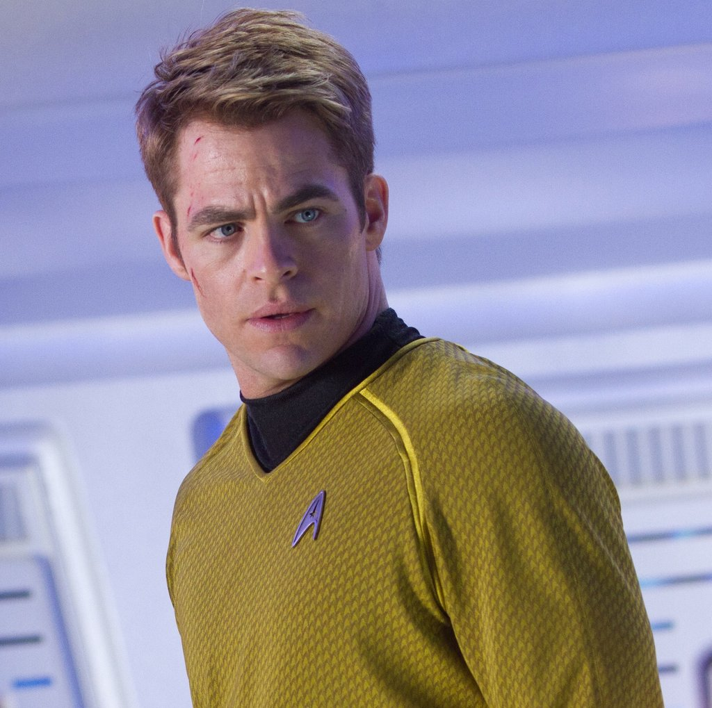 Chris Pine as James T. Kirk Only Chris Pine can make a mock turtleneck look so good. For this Summer's Star Trek Into Darkness, he's back on the USS Enterprise in his futuristic gear with a smokin' hot clean-cut look.