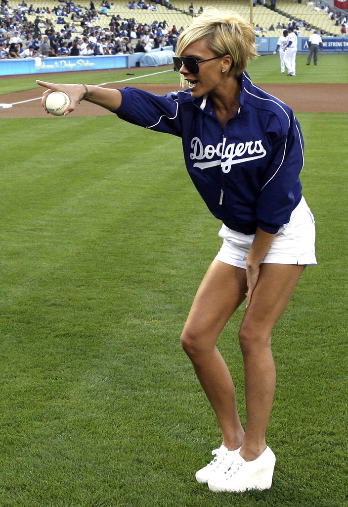 Victoria Beckham showed off her legs in short shorts to hit the field for the first pitch at the LA Dodgers game in June 2007.
