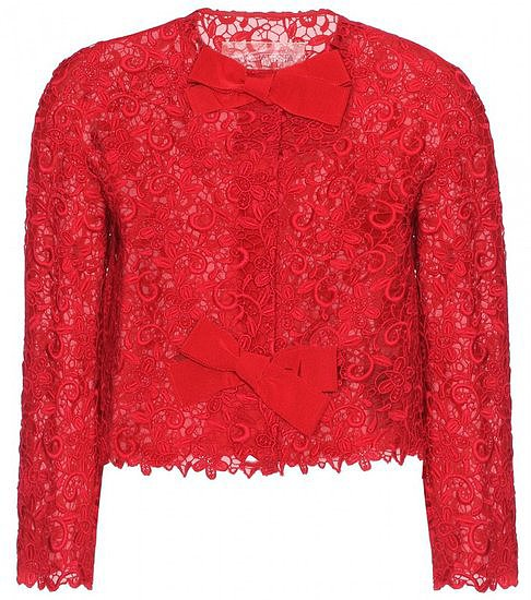 This silk organza Giambattista Valli lace jacket ($3,945) in floral macramé lace is cropped with a sweet grossgrain ribbon that keeps it very prim and proper — a sweet and sophisticated option to wear as a cover-up or pair with any length skirt.