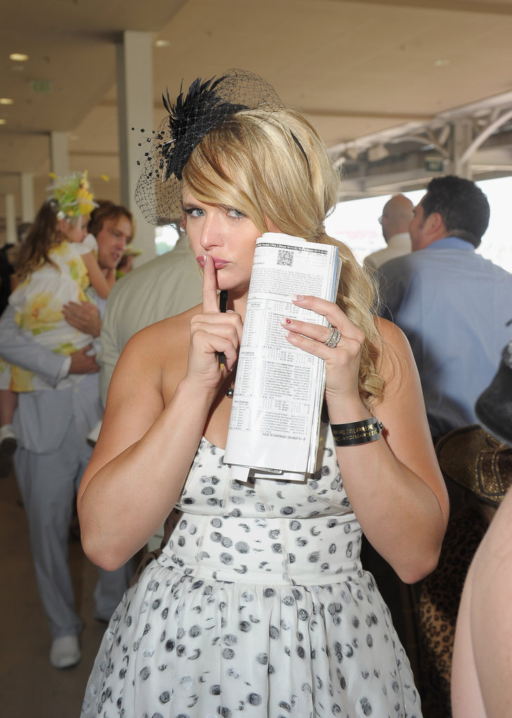Miranda Lambert kept her bets a secret while checking out the races in 2012.