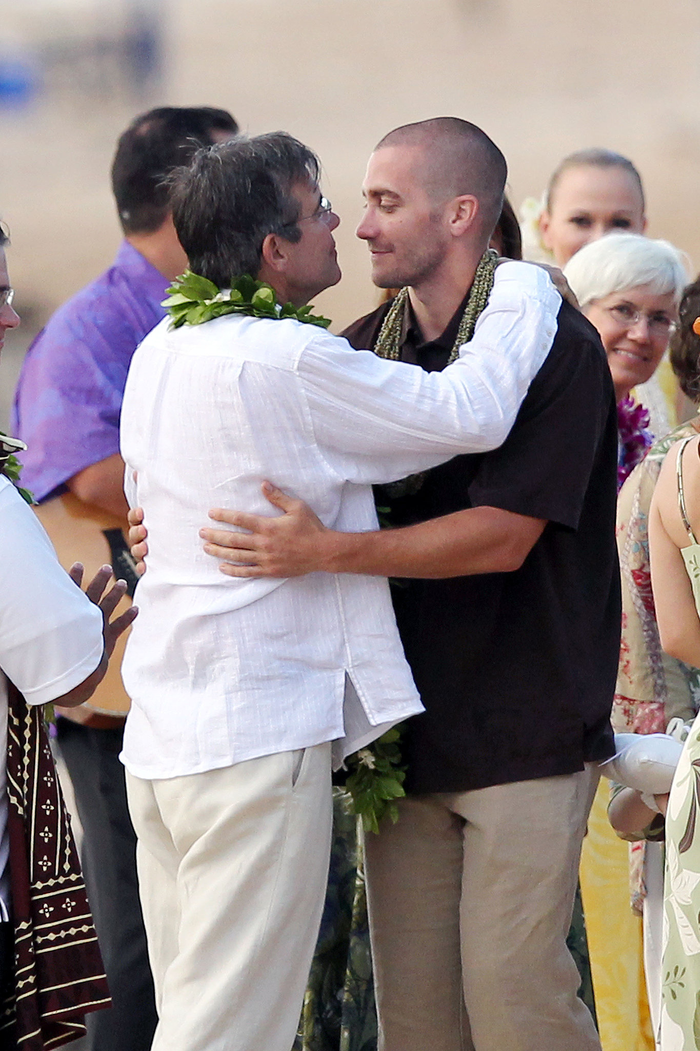 Jake Gyllenhaal hugged his dad, Stephen Gyllenhaal, at his father's Hawaiian wedding in July 2011.