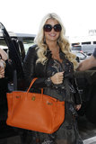 Jessica Simpson caught a flight with her family at LAX.
